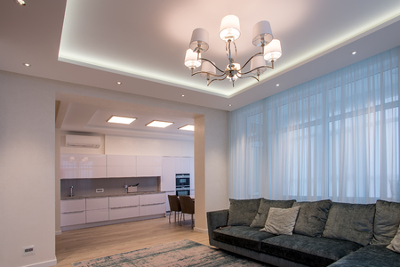 Living room beige with sofa and chandelier