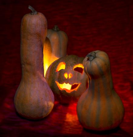 halloween, evil pumpkin candles gloom on red