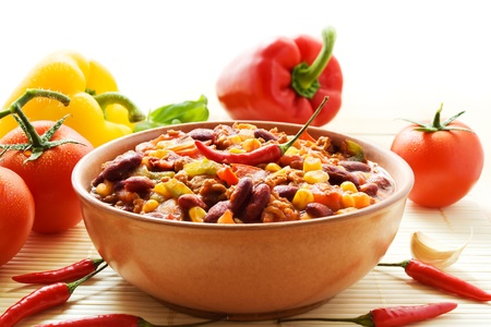hot peppers: Bowl of chili con carne with ingredients