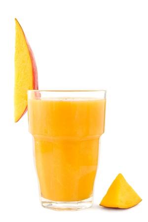 Glass of fresh mango smoothie on white. photo
