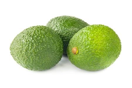 Three avocados on white photo