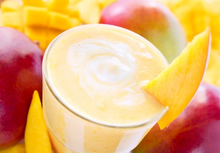 fruit smoothie: Big glass of fresh mango smoothie with mangos