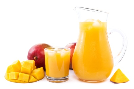 icecubes: Glass and jug full of fresh cold mango juice Stock Photo