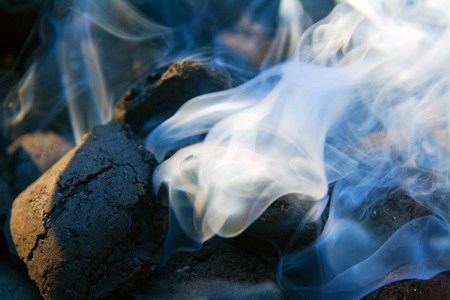 coals: Coals on a grill with smoke Stock Photo