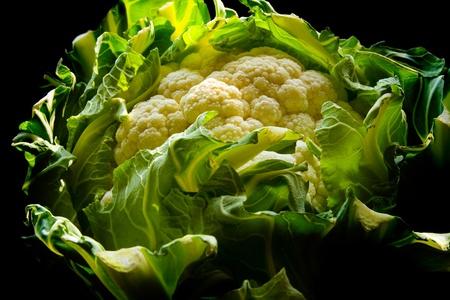 head of cauliflower: Cauliflower head on black background Stock Photo