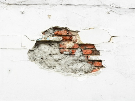 Crack in plastered wall photo