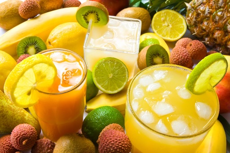 fruit juices: Group of three juices with colorful fruits Stock Photo