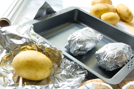 Preparing baked potatoes Stock Photo - 12421551