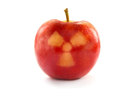 irradiated: Fresh and healthy looking red apple with a radioactive symbol