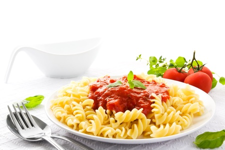 Fresh pasta on a plate with a healthy vegetarian tomato sauce Stock Photo - 12416898