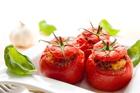 filled: Three stuffed tomatoes on a white plate