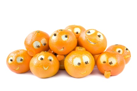 clementines: Heap of funny clementines with faces isolated on white Stock Photo