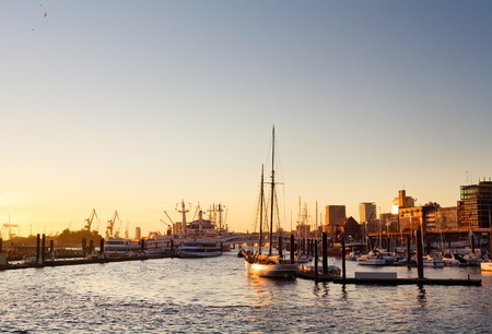 Hamburg harbor with skyline, ships and a clear sky during sunset photo