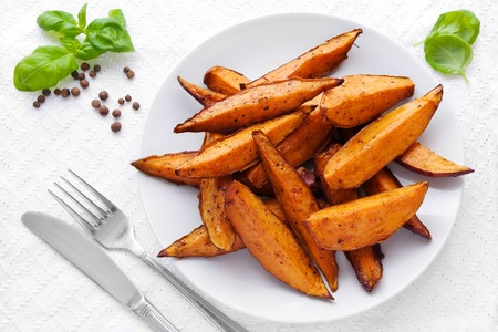 baked potato: Delicious homemade sweet potato wedges on a plate Stock Photo