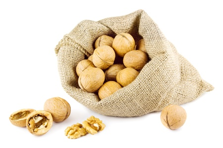 Walnuts and a bag on white Stock Photo - 13211286