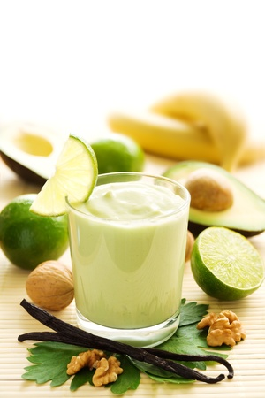 avocado: Avocado smoothie with bananas, limes, yogurt and vanilla beans Stock Photo