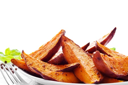 Portion of fresh baked sweet potato wedges photo
