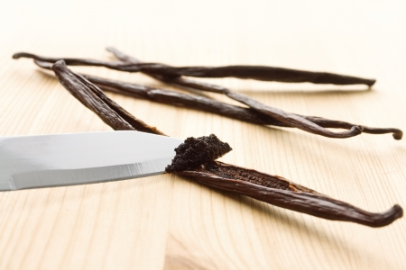 vanilla bean: Vanilla mass being scratched out of vanilla beans with a knife Stock Photo