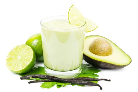 Fresh sweet avocado smoothie with avocado, limes and vanilla beans on a white background