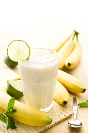 Banana milkshake or smoothie with bananas photo