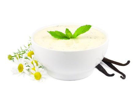 Bowl of vanilla yogurt with vanilla beans and daisy flowers on white Stock Photo - 15239271