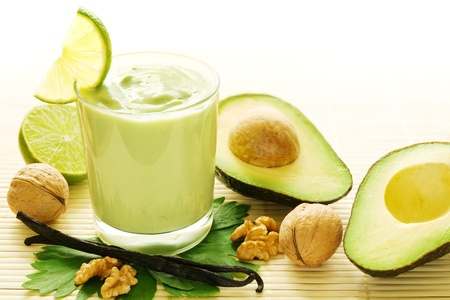 fruit smoothie: Fresh smoothie of avocados, vanilla, walnuts and limes  Stock Photo