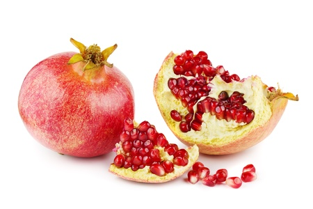 Pomegranates with one broken open on a white background Stock Photo - 17350109