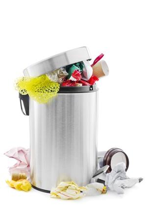 Over full trash can on white Archivio Fotografico