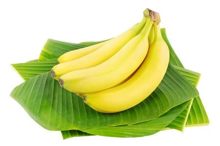 Bunch of fresh bananas on banana leaves