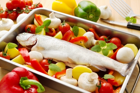 Fresh raw trout with raw vegetables in a casserole ready to be baked Stock Photo - 17719632