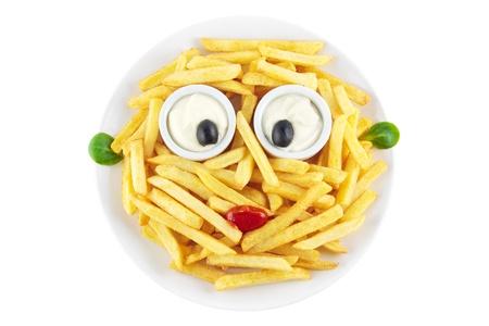 aliments droles: Frites fran�aises avec un visage dr�le isol� sur blanc