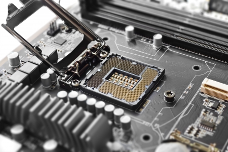 chip and pin: Empty cpu processor socket on a computer motherboard with pins visible Stock Photo