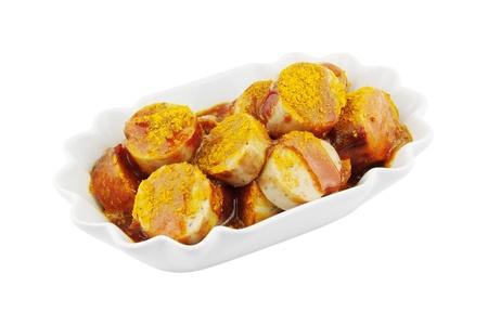 Bowl of Currywurst isoliert auf weiß Lizenzfreie Bilder