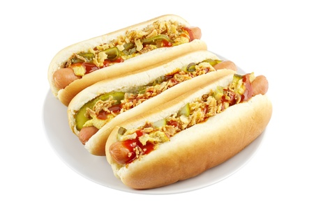 hot sauce: Three hot dogs on a plate isolated on white