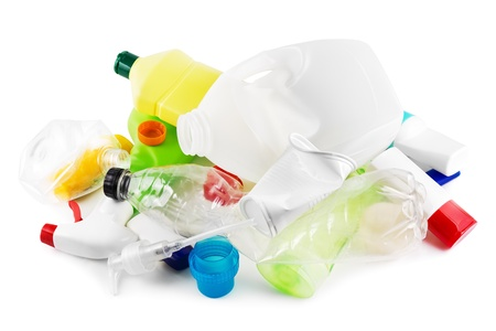 Heap of plastic garbage on white