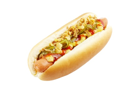 Hot dog with mustard, ketchup, gherkins, and fried onions isolated on white photo