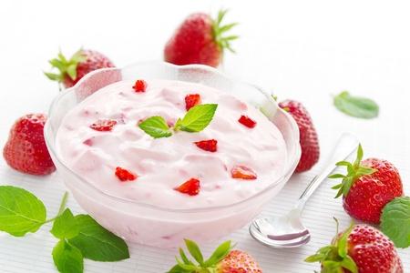 Bowl with fresh strawberry yogurt and strawberries