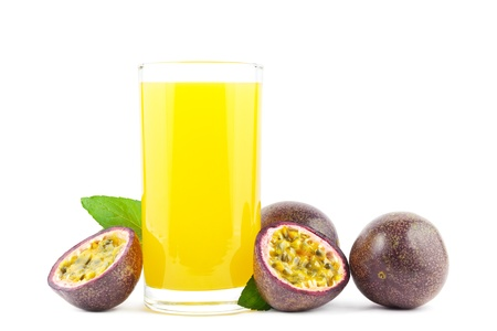 passion fruit: Fresh passion fruit juice with passion fruits on white Stock Photo
