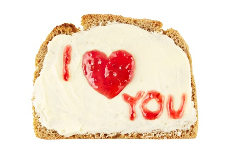 spread the word: Heart with I love you message written in sweet jam on a bread with butter