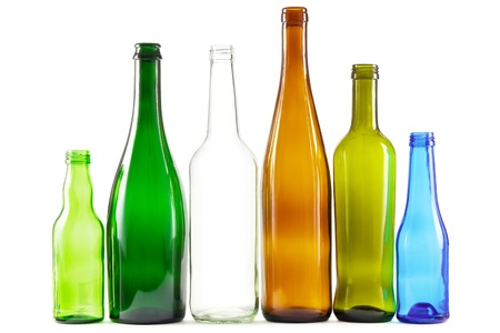 Glass bottles of mixed colors including green, clear white, brown and blue Stock Photo