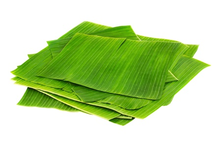 Banana leaves for wrapping or serving food as ecological dishware, isolated on white Archivio Fotografico