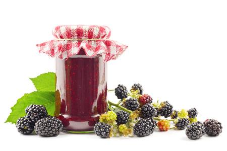 blackberries: Jar with blackberry jam with fresh blackberries on white