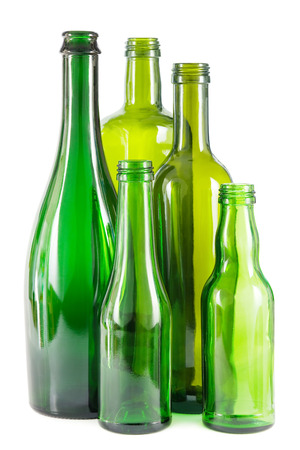 Group of empty green glass bottles on white. Archivio Fotografico