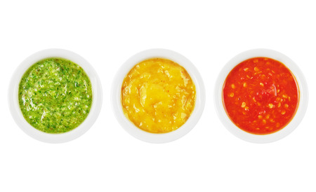 Colorful green, yellow and red spicy sauces in bowls isolated on white Zdjęcie Seryjne - 24914861