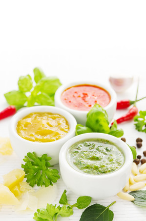 chili sauce: Assortment of three colorful hot sauces with ingredients