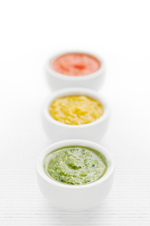 sauces: Three green, yellow and red sauces in a row