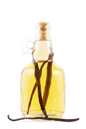 vanilla: Bottle with vanilla liqueur or essence on white.