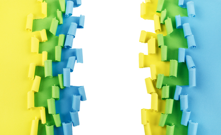 yellow green: Ripped and curled paper background in green, yellow and blue, isolated over white
