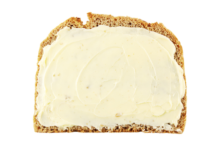 Slice of rye bread with butter isolated on white Standard-Bild