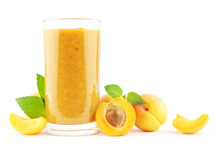 isolated on yellow: Fresh apricot smoothie with apricots on white. Stock Photo